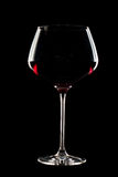 Long stem wine glass. Red wine glass isolated on a black background with a long stem Stock Photo