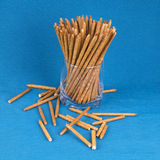 Long sticks are in a glass on a blue background. Placer salty st Stock Images