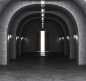Long stone corridor with an open door in the building. 3d illustration Stock Photography