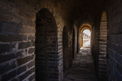 Long stone corridor with stairway in ancient castle or wall. Long stone corridor with stairway in ancient castle Royalty Free Stock Image