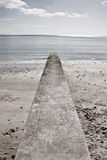 Long stone jetty Stock Images