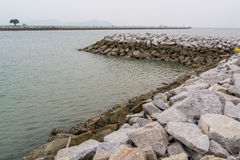 Long stone seawall Stock Image