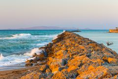 Long Stony Spit Going Far to Sea in Heraklion City on Crete stock photo