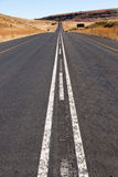 Long Straight Asphalt Road Running Through Rural Countryside Royalty Free Stock Image