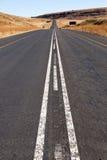 Long Straight Asphalt Road Running Through Rural C Royalty Free Stock Image