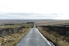 Long Straight Countryside Road. Long countryside road in the hills and mountains of England Royalty Free Stock Images