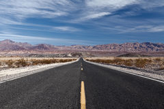 Long straight desert highway. Royalty Free Stock Images