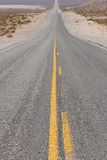 Long straight desert road Stock Photo