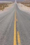 Long straight desert road. Long stretch of desert highway Stock Photo