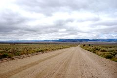 Long Straight Dirt Road in the High Plains Stock Image