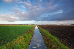 Long straight ditch Royalty Free Stock Photography