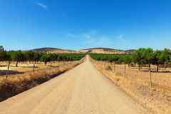Long straight gravel road Stock Photos