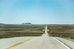 Long straight highway, blue sky, Utah Stock Photo