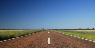 Long straight road. Wide open space and long straight flat quiet peaceful road near charlaville on a bright clear sunny morning Stock Images