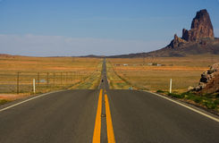 Long Straight Road. Photo of Long Straight road shot from center line. Camera facing north.  Large stone mountain in the distance Royalty Free Stock Photography