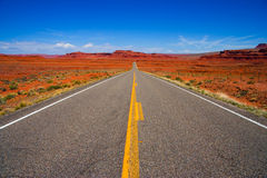 Long Straight Road. Photo of Long Straight road shot from center line. Camera facing north. Shot in Southern Utah with deep orange landscape.  No cars or road Stock Photography