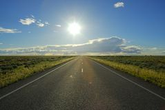 Long straight road. Traveling from Wilcannia to Brocken Hill in afternoon on long straight road Royalty Free Stock Photos
