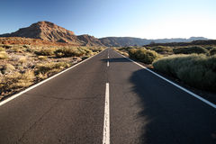 Long straight road. In a sand desert Royalty Free Stock Images