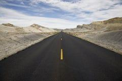 Long straight road. Through desert landscape Royalty Free Stock Photos
