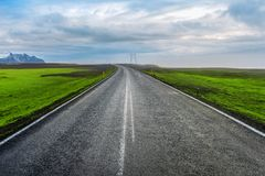 A long straight road and blue sky.  Stock Photos