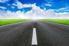 A long straight road and blue sky Royalty Free Stock Images