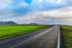 A long straight road and blue sky.  Stock Photography
