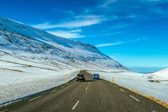 A long straight road and cars in winter stock photo
