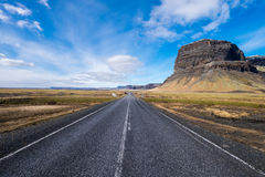 Long straight road in Iceland. Long straight road crossing the in Vik, South of Iceland Royalty Free Stock Images