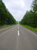 Long Straight Road of Kaiyodai in Hokkaido, Japan. Long straight road to Kaiyodai in Hokkaido, Japan.  Kaiyodai is very popular 360 degree view spot of Hokkaido Stock Image