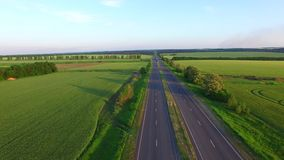 Long straight road middle of rural area stock video footage