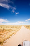The long straight road to nowhere. The long straight dirt road to nowhere Stock Photo