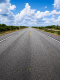 Long and straight rural road. A long and straight rural road in the scrubland of northern Brazil Royalty Free Stock Photography