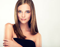 .Long, straight, shiny hair. Stock Images