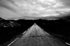 Long strait road into fog shrouded mountain range Royalty Free Stock Photography