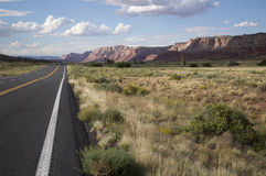 Long stretch of highway leading off into the scenic high desert Royalty Free Stock Photo