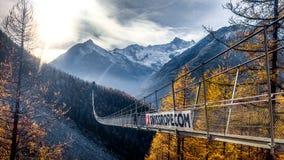 Long suspended bridge crossing abysm in Switzerland royalty free stock photo