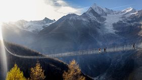 Long suspended bridge crossing abysm in Switzerland stock photo