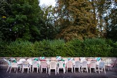 Long table and chairs with mixed upholstery outside stock image