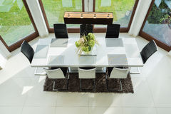 Long table in dinning room Stock Photo
