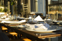 Long table in the restaurand served for several persons with gla Stock Image