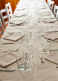 Long table with white cloth. Long dressed table with white cloth, vertical image Royalty Free Stock Photos