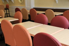 Long tables with colorful chairs in meeting room Stock Image