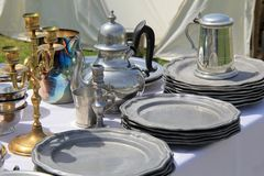 Long tables set with typical items for sale at market, seen during reenactment, Fort Ontario, New York, 2016 Stock Image
