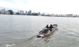 Long tail boat across mouth of Chaopraya river Stock Photos