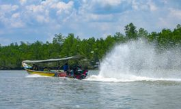 Long-tail boat in action, Thailand stock photos