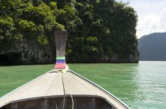 Long tail boat against blue sky in Phang Nga Bay. Thailand Stock Photo