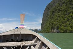 Long tail boat against blue sky in Phang Nga Bay. Thailand Royalty Free Stock Photography