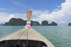 Long tail boat against blue sky in Phang Nga Bay. Thailand Royalty Free Stock Photo