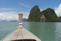 Long tail boat against blue sky in Phang Nga Bay. Thailand Stock Photos