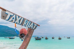 Long tail boat against cloudy sky. Stock Image